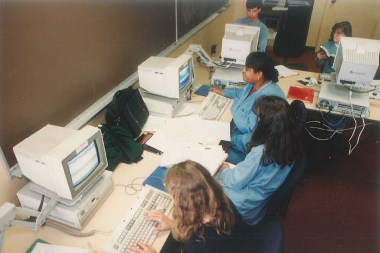 Overhead view of folks using outdated computers