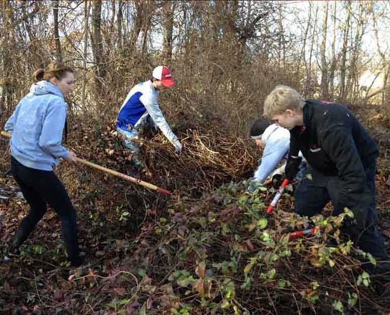 Civic Leaders clear property on Martin Luther King Day