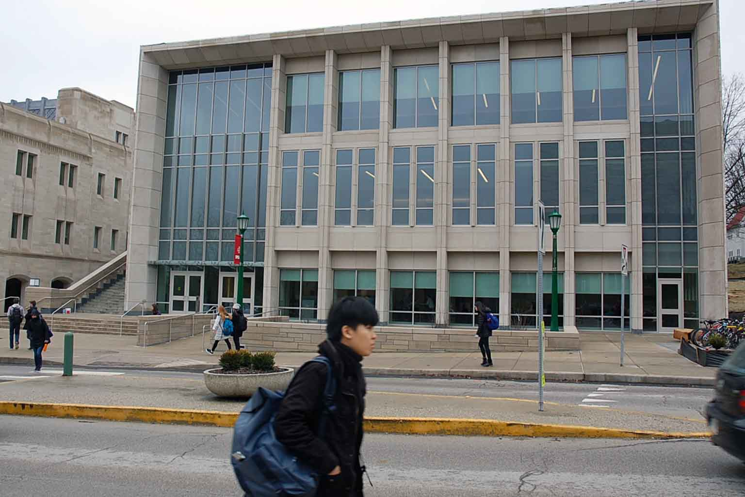 Students walk in front of the O'Neill Center expansion on a cold day.