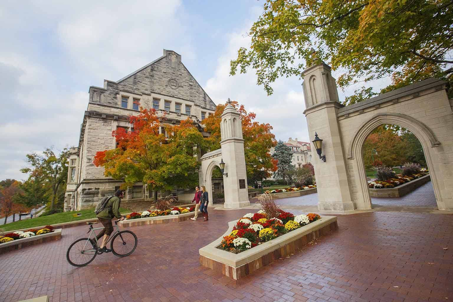 Sample Gates with lovely fall flowers and a bicyclist.