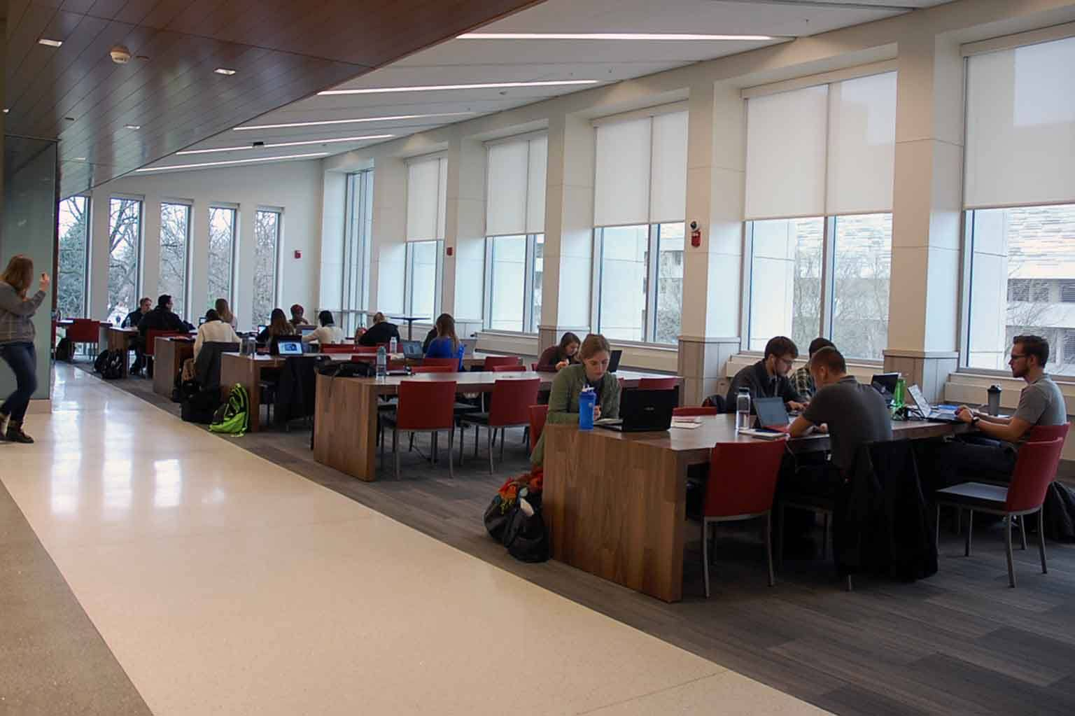 Students study at tables in the third floor commons.